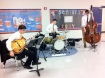 Sophomore Josh Achiron and his band kept guests entertained at the Open House.