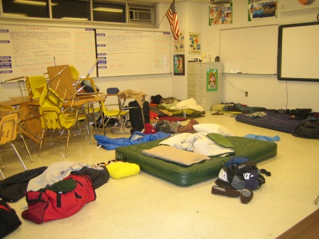 The math classrooms are transformed from desk-filled classroom to sleeping-bag-filled dormitory