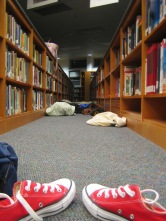 Wedged between the media center bookshelves are signs of residence