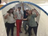 Juniors Hayley Katzenstein, Tyler Reid, and John David Grider set up a tent as their indoor campsite