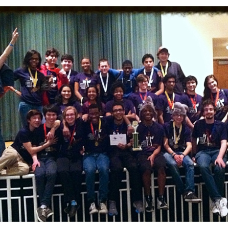 The whole gang posing after the awards ceremony with trophies and medals - and laser shark hats.