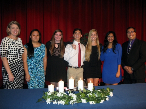 North Springs' NHS advisor, Karen Allsteadt, and officers, Cydney Wang records keeper, Hayley Katzenstein, secretary, Daniel Charanis, vice president, Juliana Abel, president, Anisha Koshy, historian, and Principal, Dr. Eddie Ruiz are standing behind the ceremonial candles representing NHS standards of scholarship, leadership, service and character used during the induction ceremony in the North Springs theater.
