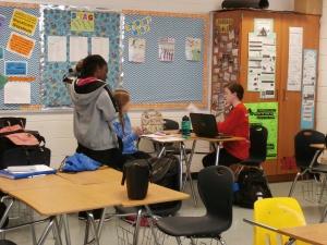 Joiya Reid, Zephyr Strosnider, and Rebecca Horn work on their stories