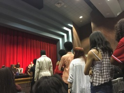 Students line up to ask Usher questions at the assembly